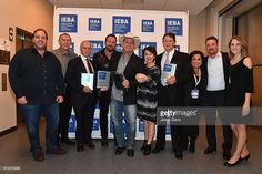 Barry Jeffrey, Todd Boltin, Bob Doyle, Lee Brice, Garth Brooks, IEBA's Pam Matthews, Ben Farrell, Risha Rodgers, Rob Beckham, and Monica Copciac pose backstage at the 2016 IEBA Honors and Awards Ceremony during day 3 of the IEBA 2016 Conference on October 11, 2016 in Nashville, Tennessee.