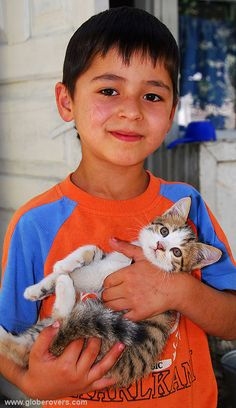 A boy and his kitten called Shashlik (which means meat-kebab in Central Asia), village of Khorog, TAJIKISTAN