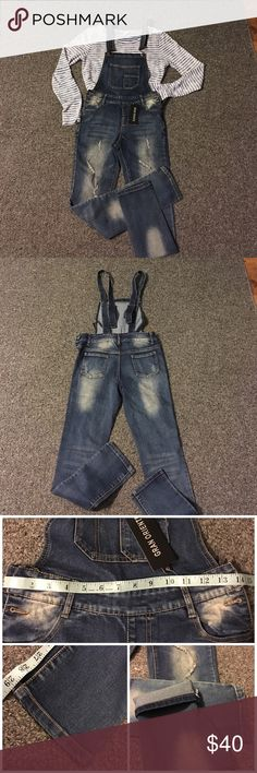 "NEW WITH TAGS: Skinny Denim Overalls NEW WITH TAGS: Skinny factory distressed Overalls. Size Medium-the equivalent to a size 26/27, inseam 29""-These are meant to be worn with cuffs rolled up. Please see pictures for complete measurements and fabric content. TOP IN PIC #1 NOT FOR SALE✳️PRICE IS FIRM✳️I DO NOT MODEL CLOTHING✳️ Jeans Overalls"