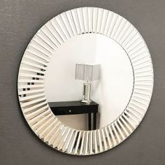 Glass framed round steps stargate mirror offering a subtle Art Deco feel with a modern twist