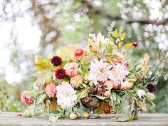 A Thanksgiving floral centerpiece featuring poppies and posies Thanksgiving Centerpieces Ideas for a Festive Table