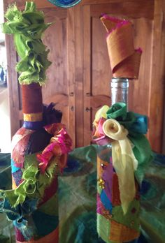 recycled wine bottles, covered in remnants of hand painted/dyed silk