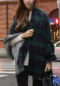 This gorgeous Reversible Double Sided Blanket Scarf is the perfect accessory for Fall & Winter. It features two very versitile prints on each side, red plaid on one side and black & white houndstooth