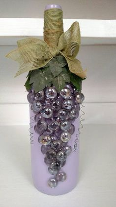 Large wine bottle painted a light purple. with jeweled grape design. #paintedwinebottles #winebottle