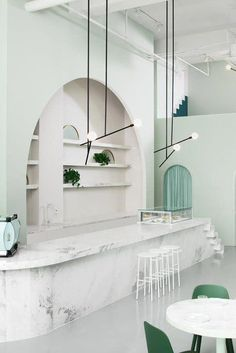 The green-toned interior design of the Budapest Café in Chengdu, China, by Biasol Studio is inspired by the style of director Wes Anderson. Arch Interior, Cafe Interior Design, Cafe Design, Home Interior, Interior Architecture, Minimalist Architecture, Scandinavian Interior, Interior Exterior, Contemporary Interior