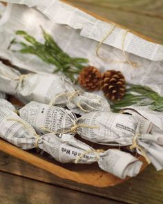 Fragrant herbal fire starters for fireplaces...would make a fun gift. love the organic look of newspapers and twine. Package with extra pinecones in a wooden bowl or basket.