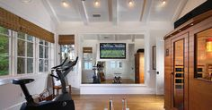 Home gym with framed TV around mirror... Brilliant!
