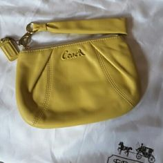 "Coach Wristlet 5 1/4"" height, 7 1/2"" width, NWOT, Yellow Coach Wristlet, gold hardware, zippered top with detachable handle. Interior lined in dark gold. 1 open pocket in main compartment. Brand new, never used, perfect condition inside & out. Coach Bags Clutches & Wristlets"