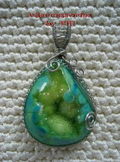 My Wire Jewelry 2010.  I'm drooling over that gemstone.  I think it's Chrysocolla.