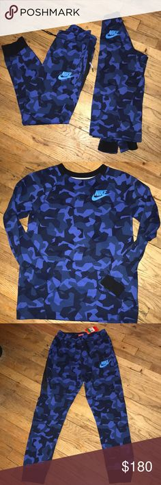Nike tech camo sweatsuit Brand new never worn only to try on.Dark royal blue & navy blue & black camouflage Nike tech sweatsuit with pouch sweater. Pants haves three pockets. The joggers pants also haves drawstrings. Tag is only on the pants not the sweater. Any more questions please feel free to ask me before purchasing. Nike Matching Sets
