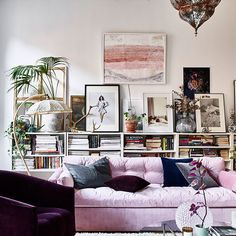 The sofa injects an accent of pink into the scheme. The sideboard behind the sofa is topped with framed paintings, drawings and photographs alongside treasured objects. May 2017 issue: Photos: Sasa Antic/ House of Pictures