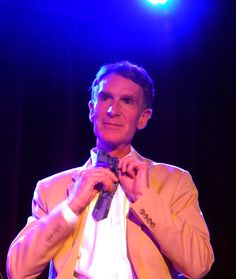 Bill Nye demonstrates the art of tying a bowtie - at StarTalk Live's Particle Party at the Bell House, Brooklyn, NY, July 11, 2012 (Photo Credit: © Stacey David Severn, All rights reserved)