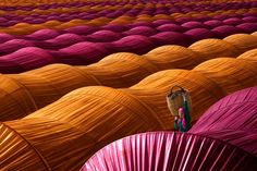 Leyla Emektar (Turkey). Strawberry Greenhouses. Winner Travel Category. Photographed in her native Turkey, Emektar's stunning image has a hypnotizingly symmetrical composition, with a female worker peeking out in between the colorful sea of greenhouses.