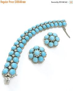 Kramer Bracelet and Earring Demi Parure, Robins Egg Blue Cabochons, and Clear Round Rhinestones, Rhodium Plated, Designer Signed, 1960s by Vintageimagine on Etsy https://www.etsy.com/listing/465173817/kramer-bracelet-and-earring-demi-parure