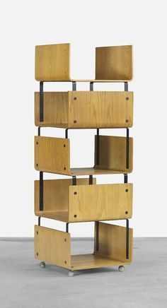 Roger Legrand; Molded Ash Plywood and Enameled Steel 'Pan-U Modular System' Bookcase for Steph Simon, 1964.