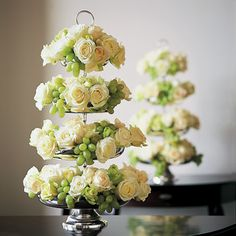 I love the look. Tiers of grapes and white roses.