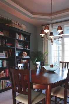 Traditional Dining Room with Wood Bookcase