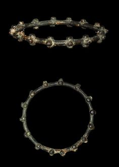 Iron Age Celtic Bronze Bangle 5th (century BC)-3rd century AD . A cast bronze bangle of expanding section with fifteen trefoil lugs to the outer faces.