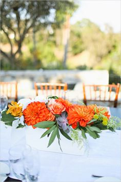 modern summery floral centerpieces #dalias #floralarrangements #tablescape http://www.weddingchicks.com/2013/11/07/beverly-hills-backyard-wedding/