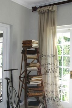 Just what I was looking for; an idea for the drop cloth curtains for my booth display.