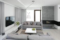 Salon to najważniejsza przestrzeń w domu. Na pokój dzienny wybieramy zazwyczaj największe i najlepiej doświetlone pomieszczenie. Zobacz, jak urządzić jasne wnętrze – prezentujemy aż 30 salonów z polskich domów! Living Room With Fireplace, Living Room Grey, Living Area, Flur Design, Hall Design, Design Hall Entrada, Interior Decorating, Interior Design, Interior Architecture