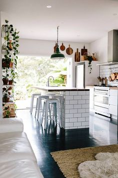 kitchen, dark floors, timber features, green wall, subway tiles