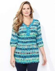 Our irresistible tunic features an allover striped diamond pattern you are sure to love. Cascading pleats gracefully release at the hem for a feminine finish. Crochet trim at the neckline and inserts on the sleeves add a lovely contrast against the print. V-neckline. Three-quarter sleeves. Catherines tops are perfectly proportioned for the plus size woman.  catherines.com