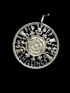 Silver two schilling coin cut out to make a pendant