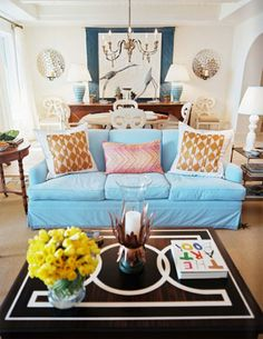 cute light blue sofa and silver sconces. DIY painted coffee table idea.