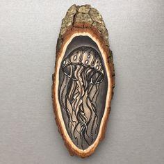 Wood slice with an original drawing of a jellyfish door Inkspirednl