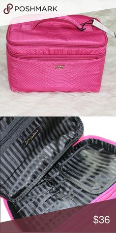 VS Python Large Make up Train Case New with tag  This is part of a Duo but the smaller bag is not for sale as I have used it personally. This train case which is the bigger case is brand new with brush holders and two compartments.   Firm! No trade   Thank you very much Victoria's Secret Bags Cosmetic Bags & Cases