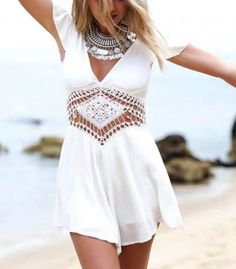 Playsuit with lace embroidery at the waist