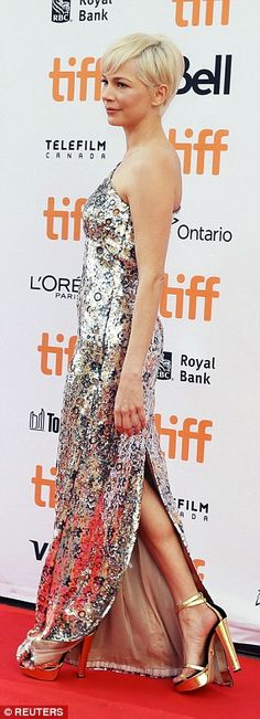 Flaunt it: The pixie blonde haired actress wore a one shouldered, elaborate sequined dress that showed off her slender physique