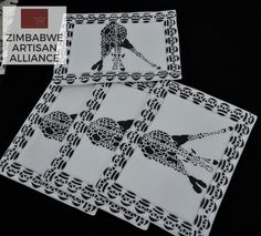 """Black and White Giraffe Print Placemats"" Zimbabwe Textiles Setof4 hand printed Africanplacemats.  TheseplacematsarehandprintedbyZimbabweanwomenwhoworkfrom home. TheirwaresarethensoldattheAvondaleMarketinHarare, Zimbabwe.  This set was made by the artist Patricia."