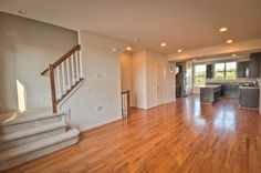 Townhome in Frederick, MD. The main level features all of your living in one open space; very New York loft inspired! Hardwood floors, dark cabinets with light granite, recessed lighting, big windows and 9 foot ceilings. Click on the picture for the floor plans!