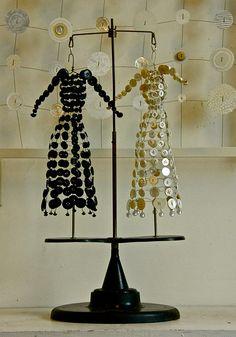 ButtonArtMuseum.com - beautiful tiny antique button dresses, It is work by artist Janet van Fleet