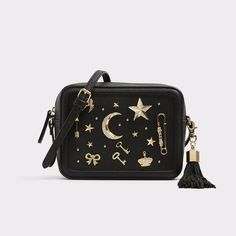 Yoisa Eye-catching glamour and celestial shimmer adorn this small, yet specious crossbody bag. Gold accents and an oversized tassel detail, make it ideal for injecting your days and evenings with luxe edge.