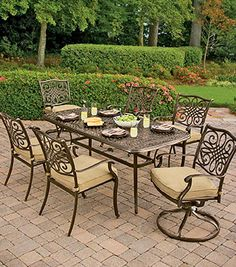 Dining outdoors becomes even more attractive with this 7-piece set from the Traditions Collection. The ornate scrollwork on 4 cushioned chairs, 2 cushioned swivel chairs, and a spacious dining table is a feast for the eyes. Online only. #shopko