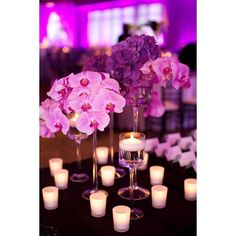Delicate & lovely candle decorations look beautiful w/ the florals and purple lighting. Photo via #ArdenPhotography #ChristopherConferoDesign