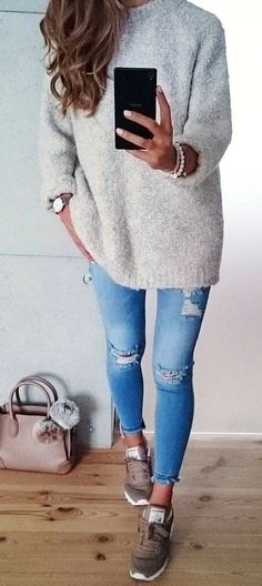 #winter #outfits gray crew-neck sweater and distressed blue stone-washed denim jeans