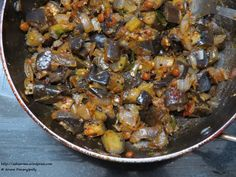 Clean the brinjals with a neat cloth after washing them with water.  Take a pan and heat it on a stove, and now add oil.  Cut brinjals to medium size and put them in pan when oil get hot and fry them until they become golden color.  Dry these fried brinjals on a paper to move excess amount of oil.