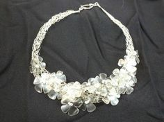 25 09 2012 06 48 36 Recycled plastic bottles necklace in plastics jewelry… Plastic Bottle Crafts, Plastic Jewelry, Recycle Plastic Bottles, Recycled Jewelry, Recycled Bottles, Recycled Crafts, Bottle Jewelry, Bottle Necklace, Recycling