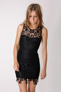 This dress has the femininity and still maintains the sex appeal.  The femininity is played up with the lace but the sex appeal is in the length.  Comes in white too!