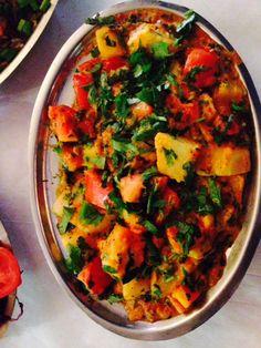 Nirvana Indian Cuisine: Tomato, potato, and cilantro dish