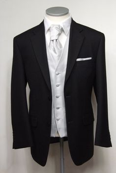 "Black herringbone grooms lounge suit. Choose from our wide range of wedding waistcoat's in a variety of styles. Mens sizes from 32"" chest upward and include extra short, short, regular, long and extra long fittings. Boys sizes from 20"" chest to 34"" chest. Complete outfit includes jacket, trousers, hire or matching waistcoat, brand new traditional or French wing shirt in white or ivory, tie or cravat, braces and cufflinks. £125.00 to hire #groom #wedding #suit #suithire #waistcoat #black"
