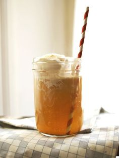 Spiked Apple Cider Float...ok this is much more elaborate than my version if just hearing up cider in a pot on the stove and pouring rum in it...