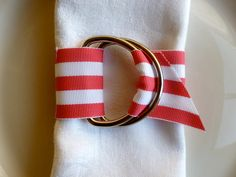 Would be easy to DIY // Set of 6 Pink & White Striped Grosgrain D-Ring Napkin Rings by ValMichaels for Valentine's Day. $23.00, via Etsy.