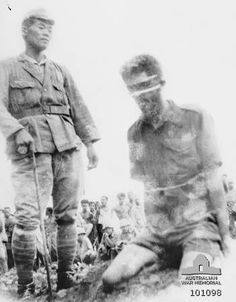 "Aitape, New Guinea. 24 October 1943. A photograph found on the body of a dead Japanese soldier showing NX143314 Sergeant (Sgt) Leonard G. Siffleet of ""M"" Special Unit, wearing a blindfold and with his arms tied, prior to being beheaded with a sword. The Japanese soldier to Siffleet's left is Chief Petty Officer Watanabe Teruo. A group of local men and Japanese stand and crouch in the background. The execution was ordered by Vice Admiral Kamada."