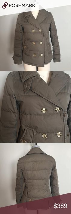 """Burberry Brit Puffer Military Pea Coat Med Burberry Brit Puffer Coat This coat is military inspired, its a double breasted pea coat style. This is a beautiful olive green color. Its slightly distressed but thats how it came when I purchased it new from Bloomingdales. Overall its in great shape. I got it for a gift wore it off and on but just had a baby and it does not fit me anymore. Size: Medium (in my opinion is fits a little small for a med) Underarm to Underarm across the front: 18.75""""…"""