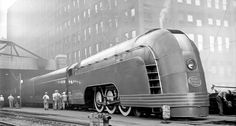 The Mercury streamliner, designed in Art Deco-style by Henry Dreyfuss for the New York Central Railroad. Here's one in Chicago in 1936.